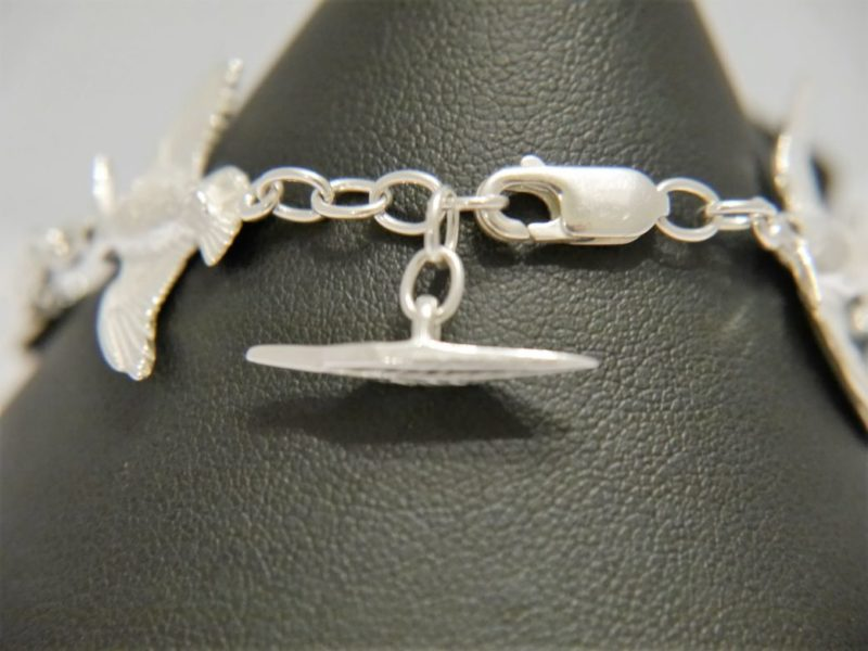feather-charm-on-clasp-fastening-bracelet