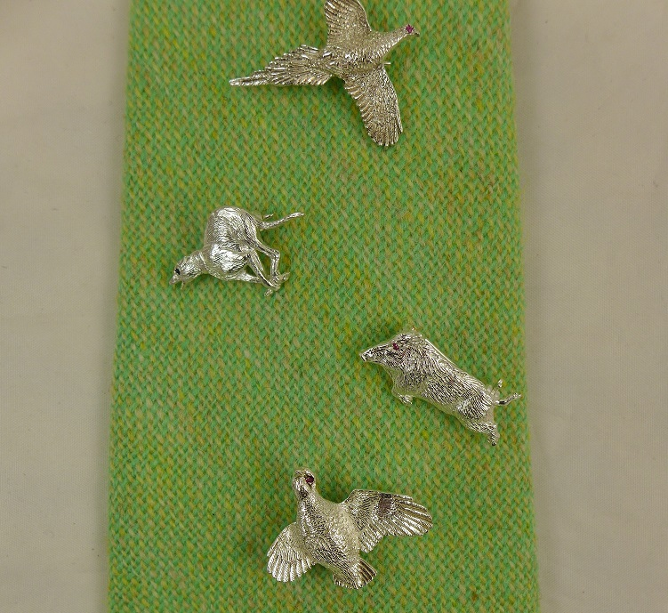 Silver Brooches or Cap Badges