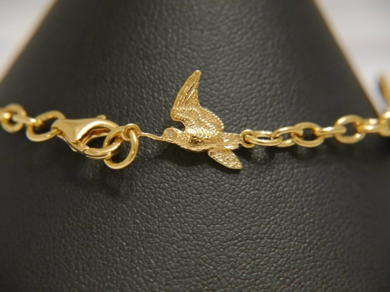 bird-charm-from-silver-gilt-bracelets
